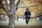 18912836-young-man-in-autumn-park