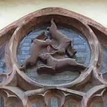 220px-Paderborner_Dom_Dreihasenfenster[1]
